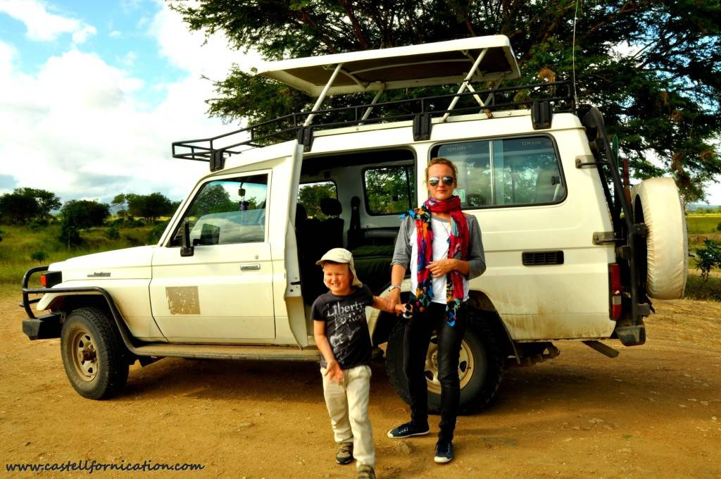 Mikumi Park game drive - out of  the the car with kid